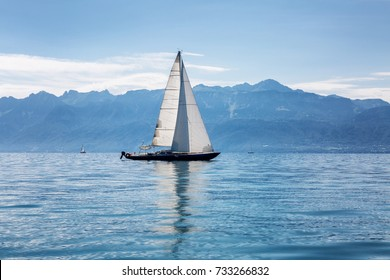 Sailing yacht, sea, mountains, blue sky
