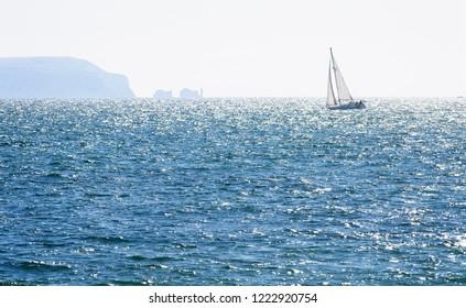 Sailing yacht at sea off the Needles, Isle of Wight, Hampshire, England, UK.