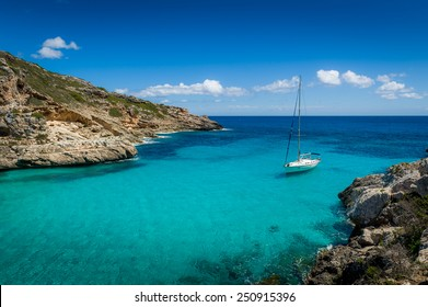 Sailing yacht stay in dream bay with turquoise transparent water. Mallorca island, Spain