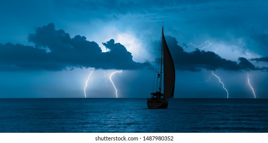 Sailing yacht in a stormy weather with lightning