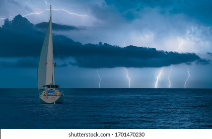 Sailing yacht in a stormy weather with thunder and lightning