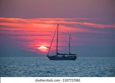 sailing yacht in sunset in the approach of Darwin, Northern territories, Australia