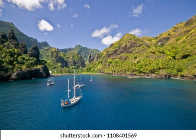 sailing yachts anchoring in the Bay of Vergins, Fatu Hiva Island, Marquess Islands, French Polynesia