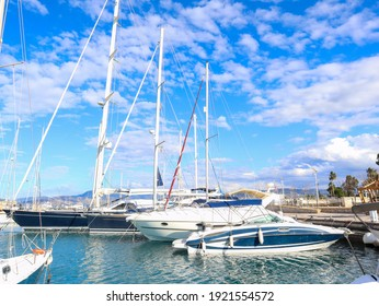 Sailing yachts with high masts of various sizes at the pier in the port of Polis.