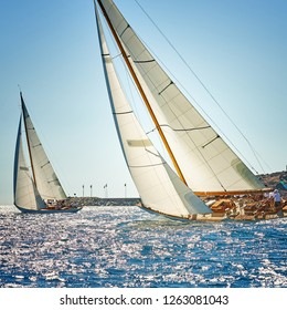 Sailing yachts race regatta. Sailboats in the sea under sail. Yachting sport and travel