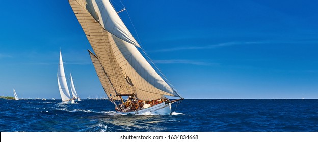 Sailing yachts race in strong wind