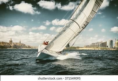 . Sailing yachts regatta.  Yachting. Sailing. Toned image and blur. Retro style postcard.