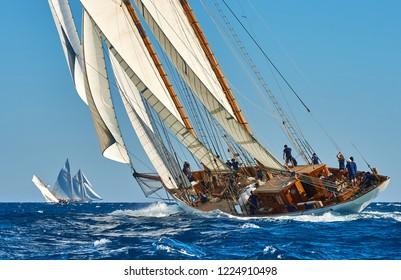 Sailing yachts and ship under sail at the regatta. Yachting sport