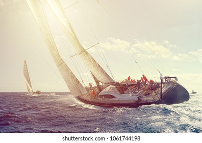 Sailing yachts and sun rays. Sailing yacht regatta. Yachting