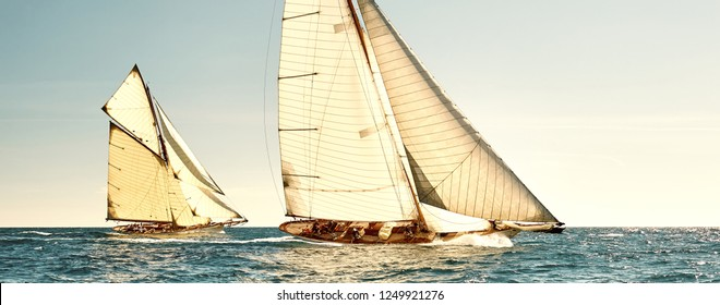 Sailing yachts under full sails at the regatta. Yachting team competition