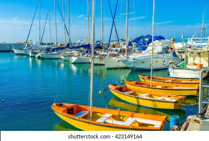 The sailing yachts wait in port for the romantic trips, Jaffa port, Tel Aviv, Israel.