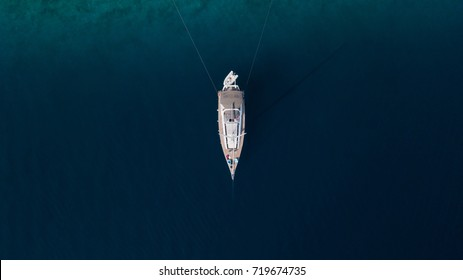 Sailing yatch anchored to the shore