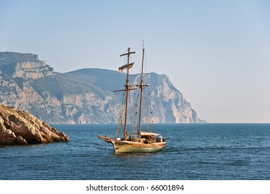 Sailing-vessel on a background mountains