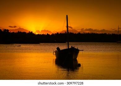Sailor boat at sunset