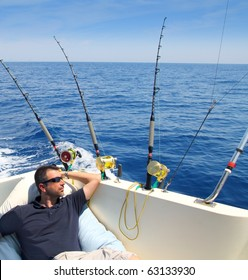 Sailor man fishing resting in boat summer vacation blue sea
