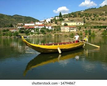 sailor rowing a traditional rebelo boat in the douro river current