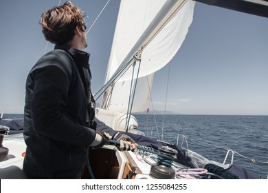 Sailor sets sail on a sailing yacht.