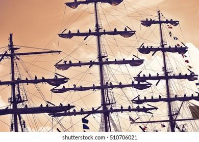 Sailors at the mast of a tall ship regatta.