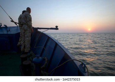 Sailors are waiting for raising the trawl, nets. Ukraine, Sea of Azov, fishing boat engaged in industrial fishing