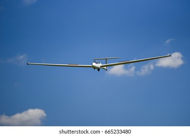 Sailplane flying on the blue sky.