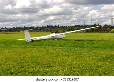 Sailplane, glider airplane wide angle shot on the ground field