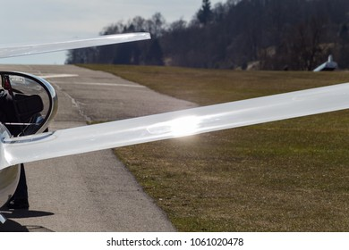 sailplane glider on south germany airfield with green grass and blue sky sunny easter springtime day