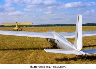 Sailplane and a towing aircraft starting on an airfield