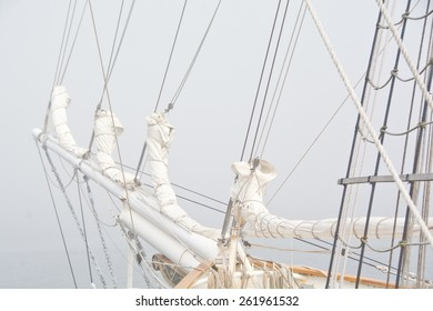 Sails are bound for storage on this well-rigged schooner.