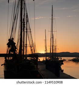 Sails at Sunset, Oban Bay. Yachts and Tall Ships moored alongside the North Pier Marina at Oban. With the hills of the Isle of Lismore and the Morvern Peninsula in the background