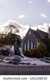 Saint Alban Church (The English Church). Built from 1885 to 1887. By A. Blomfield in Gothic Revival Style. Gefion Fountain, donated by the Carlsberg Foundation. October 3, 2018. Copenhagen, Denmark.