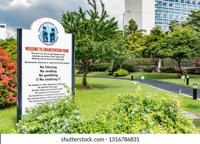 Saint Andrew, Jamaica - February 05 2019: Welcome sign at the Emancipation Park in New Kingston, Jamaica with Jamaica Pegasus Hotel in the background