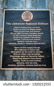 "Saint Andrew, Jamaica - February 05 2019: The Jamaican National Anthem ""Jamaica Land We Love"" and the Jamaican Coat of Arms at the top with National Motto ""Out Of Many One People"""