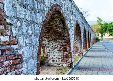 Saint Andrew, Jamaica - September 05 2015: The aqueduct at the UWI Mona Campus in Saint Andrew, Jamaica which once carried water throughout the Mona Hope Estate in its days as a Sugar Plantation