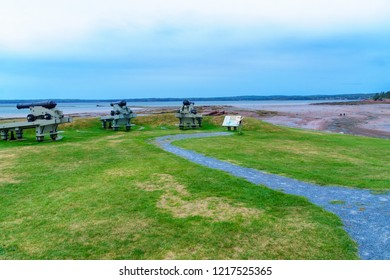 Saint Andrews, Canada - September 25, 2018: View of guns, coast and visitors in the St. Andrews Blockhouse National Historic Site, New Brunswick, Canada