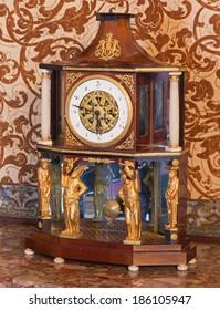 SAINT ANTON, SLOVAKIA - FEBRUARY 26, 2014:  Empire table clock from 19. cent. in palace Saint Anton.