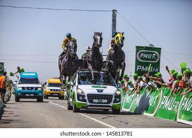 SAINT AOUSTRILLE,FRANCE- JUL 12: The vehicle of PMU in the publicity caravan at the intermediate sprint line during the stage 13 of Le Tour de France on July 12, 2013 in Saint Aoustrille.
