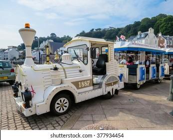 SAINT AUBIN, BAILIWICK OF JERSEY - SEPTEMBER 7, 2014: Touristic Le Petit Train. Saint Aubin, Channel Islands
