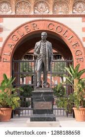 SAINT AUGUSTINE, FLORIDA, USA - DECEMBER 8, 2018: Henry Morrision Flagler statue outside the Ponce de Leon Hotel on King Street on the campus of Flagler College in St. Augustine