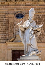Saint Augustine statue in front of the St Augustine convent in Victoria, Gozo, Malta.