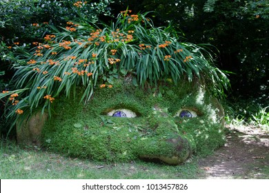 Saint Austell (England), UK - August 19, 2015: A statue in The Lost Gardens of Heligan, Cornwall, England, United Kingdom.