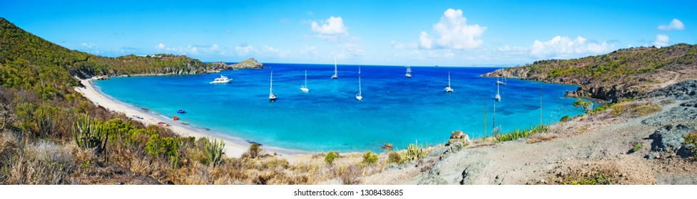 Saint Barthelemy (St Barth, St. Barths or St. Barts), Caribbean Sea, French West Indies, Greater Antilles: panoramic view of the secluded Colombier beach and bay, also called Rockefeller beach
