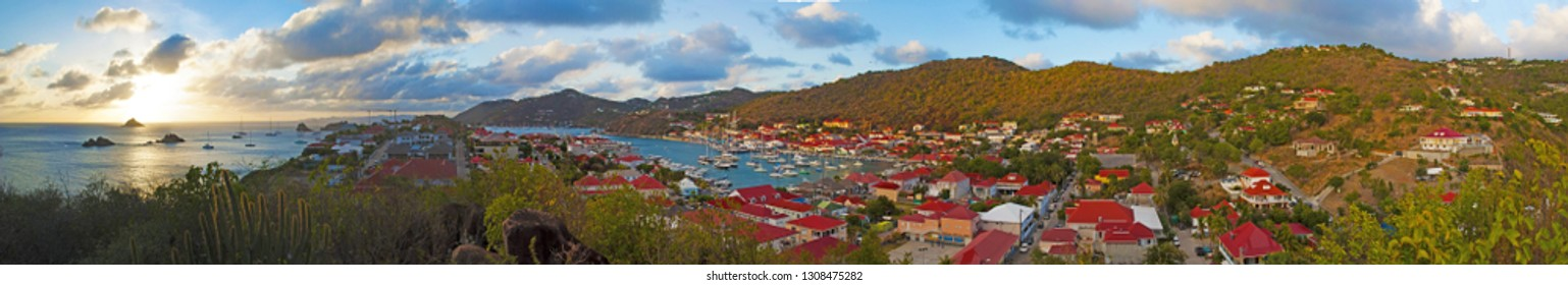 Saint Barthelemy (St Barth, St. Barths or St. Barts), Caribbean Sea, French West Indies, Greater Antilles: arial view of the skyline of Gustavia with sailboats and yachts in the harbour at sunset