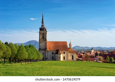 Saint Bartholomew Parish Church and scenery in Old center in Slovenska Bistrica near Maribor in Slovenia. City travel in South Styria in Slovenija. Bell tower of Cathedral in Slovenian town.