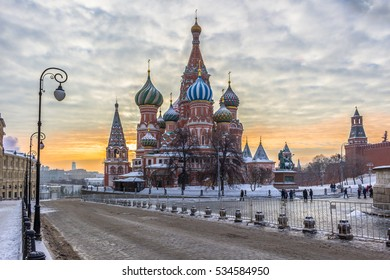 Saint Basil's Cathedral in Red Square at winter morning. Road, light poles and colorful sky. Moscow, Russia