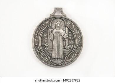 Saint Benedict cross medal backside on white background