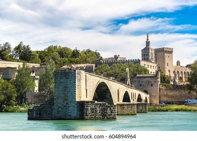 Saint Benezet bridge and Palace of the Popes in Avignon in a beautiful summer day, France