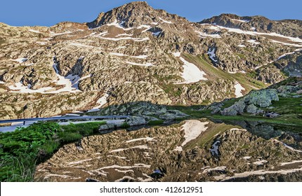 SAINT BERNARD PASS,SWITZERLAND - JUNE 6, 2015.Summer evening landscape,water reflection of the mountains,on the Great Saint Bernard Pass, ancient road along the Aosta Valley from Italy to Switzerland.