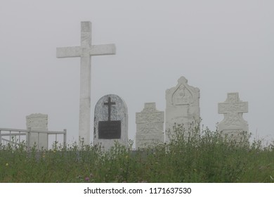 SAINT BRIDE'S, NEWFOUNDLAND/CANADA - JULY 26, 2018: Tombstones in the fog at the cemetery of the Sacred Heart Catholic Church on Main Street in Saint Bride's
