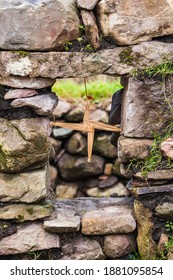 Saint Brigid's cross made from straw stuck in window and blessed the house and protected it from fire and evil. Concept: religion, irish, traditional