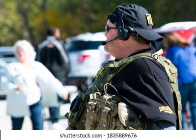 SAINT CHARLES, MISSOURI - October 17, 2020: A member of the Oath Keepers right-wing militia group wearing a tactical vest attends a Back the Blue rally.
